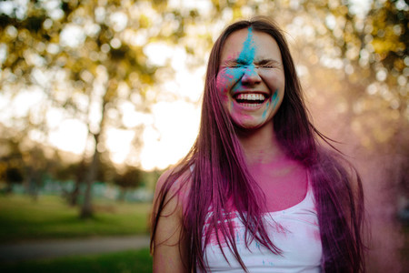 Smiling woman smeared in colors