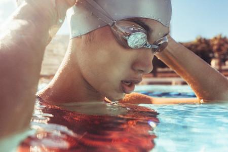 Female swimmer taking a break while training