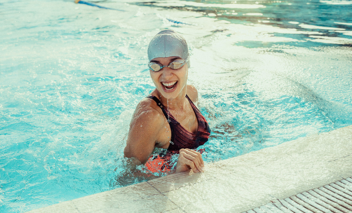 Professional swimmer smiling in pool