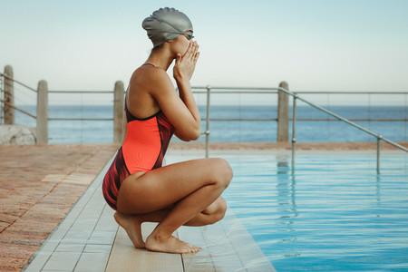 Female swimmer preparing for a swim