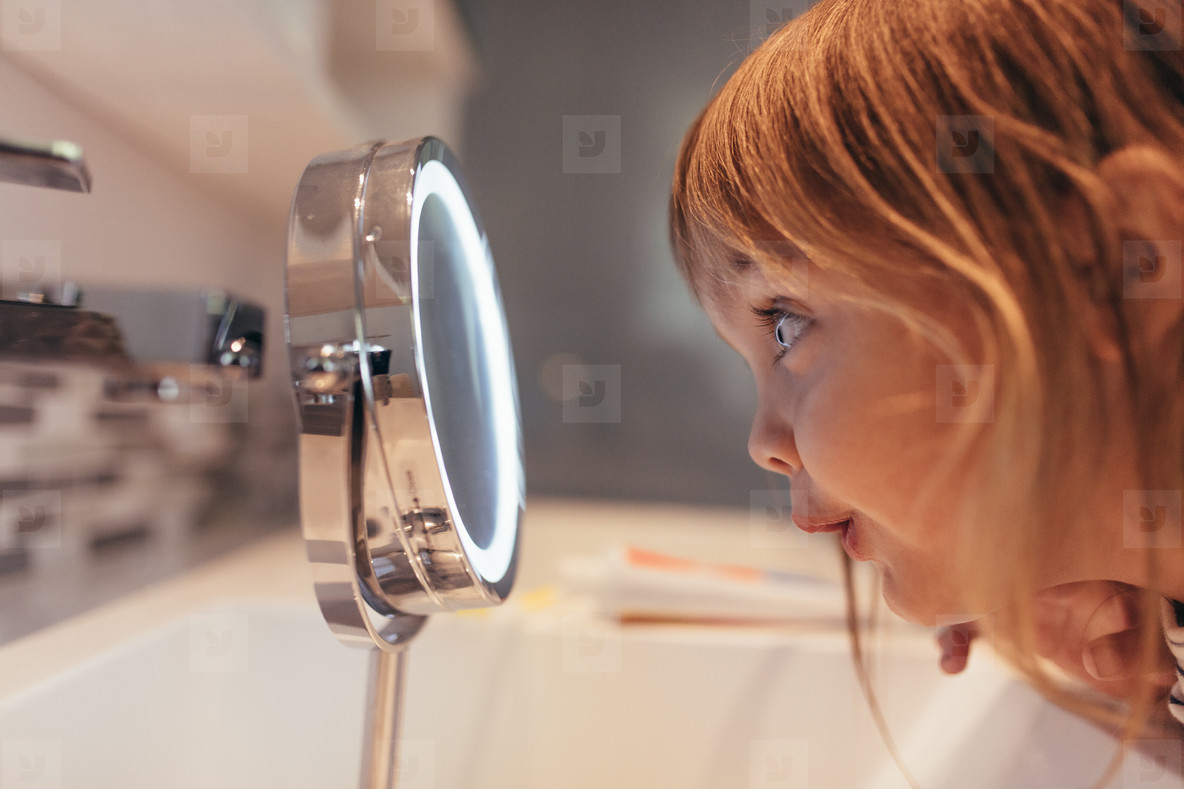 Girl looking in a mirror