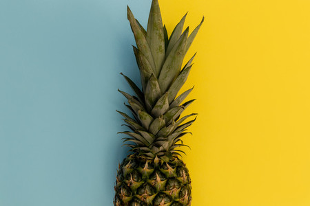 Pineapple fruit on yellow background minimal summer food concept