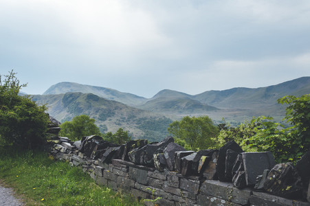 Old fence view in the great landscape of Dinorwic Quarry at Snowdonia National Park in North Wales