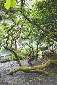 Backpackers in the path visiting the ancient Dinorwic Quarry at Snowdonia National Park in North Wales