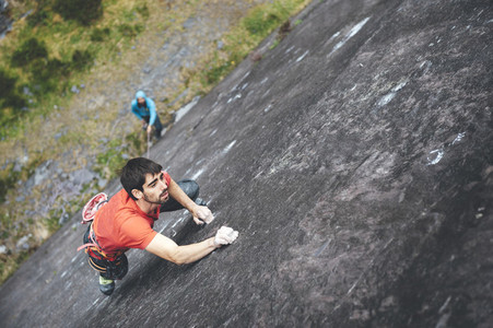 Climber climbing at stuning walls of the ancient Dinorwic Quarry at Snowdonia National Park in North Wales