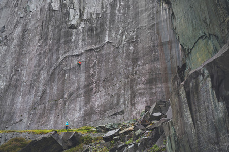 Climber climbing at stuning walls of the ancient Dinorwic Quarry at Snowdonia National Park in North Wales
