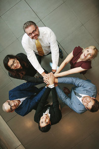 Business team hands stacked together
