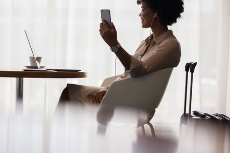 Woman at airport lounge making video call