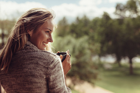 Attractive woman having coffee in morning
