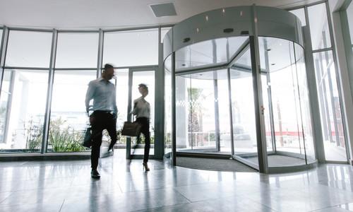People walking in office entrance hall