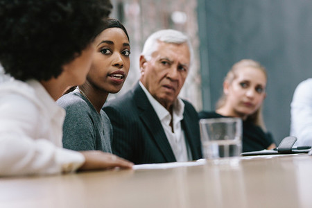 Woman sharing her ideas during staff meeting