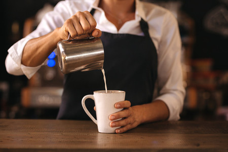 Professional barista preparing espresso on counter