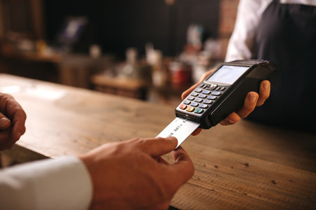 Customer doing payment credit card in cafe