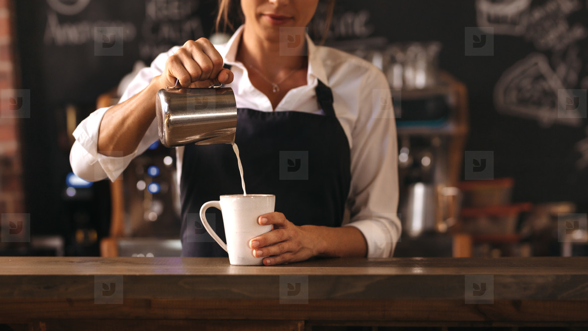 Photos - Female barista making a cup of coffee 148478 ...