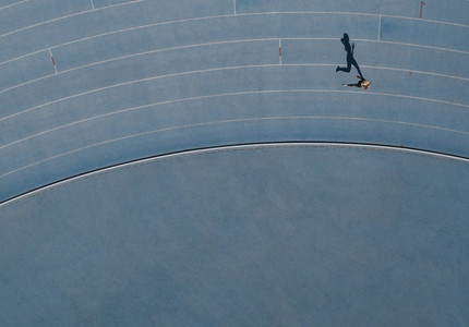 Aerial view of an athlete running on track