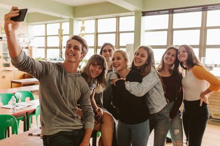 Students taking selfie in classroom