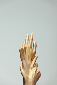 Woman hands painted in gold