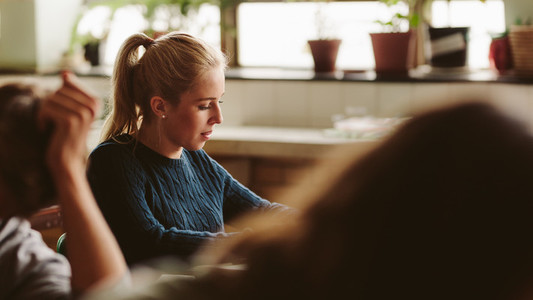 Teenage girl studying in college classroom