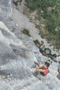 Male climber climbing on a tufa limestone wall