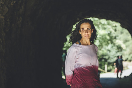 Portrait of mature woman climber in a rock cave