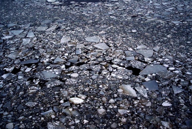 Blocks of ice in dark water
