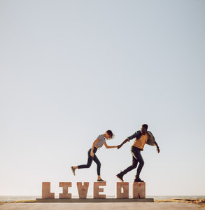 Friends walking over a word LIVE ON