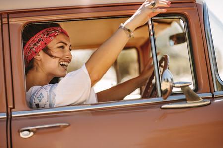 Woman enjoying driving car