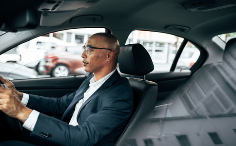 Businessman driving his car to office