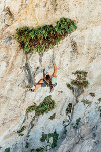 High angle view of rock climber on a overhanging limestone cave