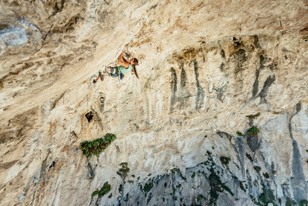 High angle view of rock climber on a overhanging limestone caves  Spain