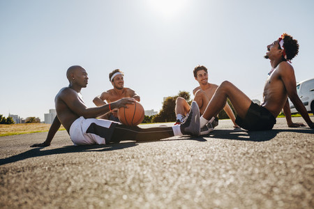 Men relaxing during a basketball game