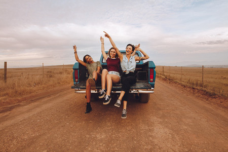 Women enjoying the pickup truck ride