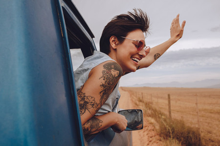 Beautiful woman enjoying road trip