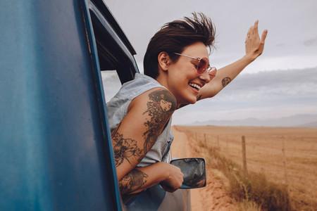 Beautiful woman enjoying road trip
