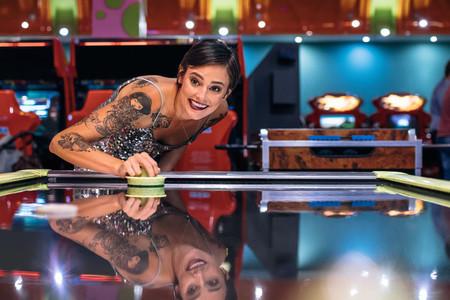 Woman playing air hockey game at a gaming arcade