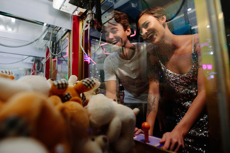 Couple playing games at a gaming arcade