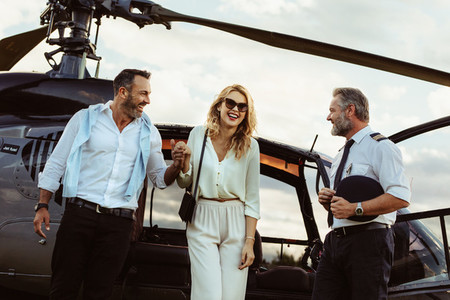 Loving couple traveling by their helicopter