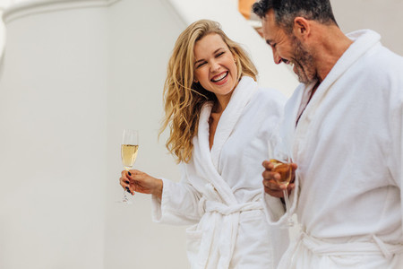Cheerful couple in bathrobe