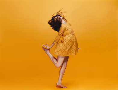 Woman dancing in orange dress