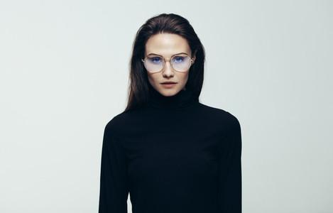 Woman in black dress staring at camera