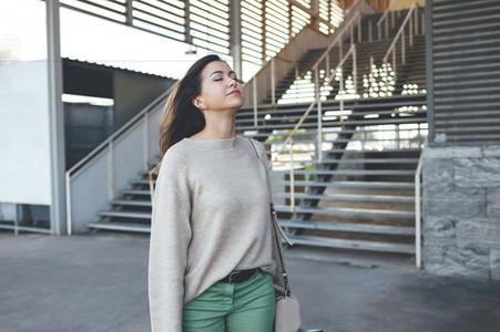 Pretty millennial woman enjoying fresh air