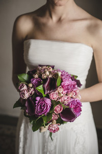Bride holding her colorful bridal bouquet