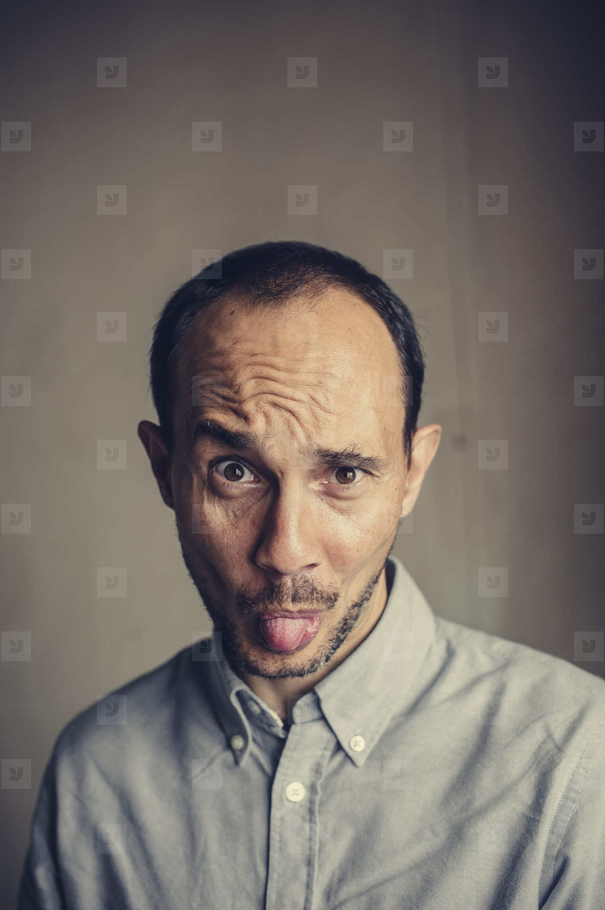 Funny mid aged bearded man joking