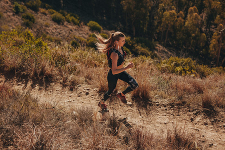 Woman trail runner training for cross country run