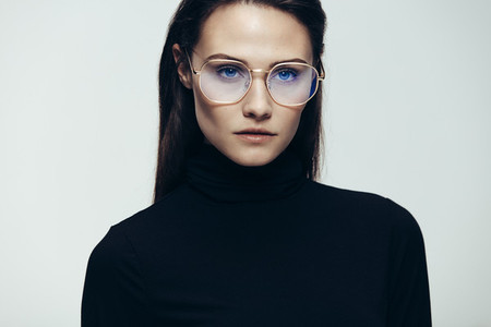 Woman in glasses with intense expression
