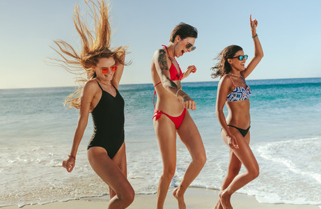Women dancing on beach