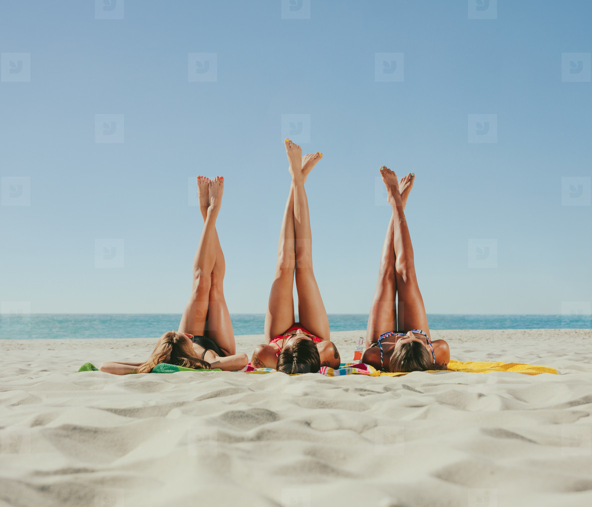 Photos - Woman In Bikini Sunbathing On Beach With Legs -6078
