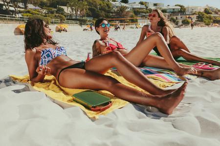 Women on vacation sunbathing on beach