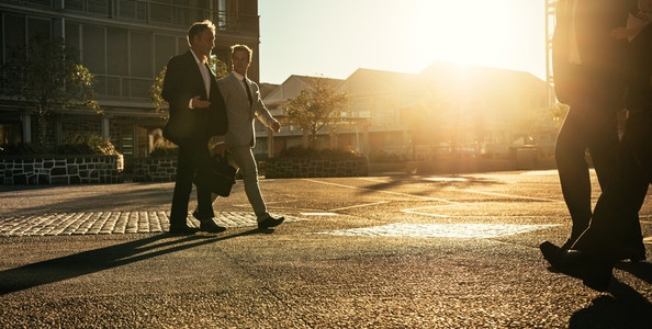 Business people walking to office early in the morning