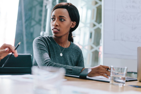 Young african woman in business meeting